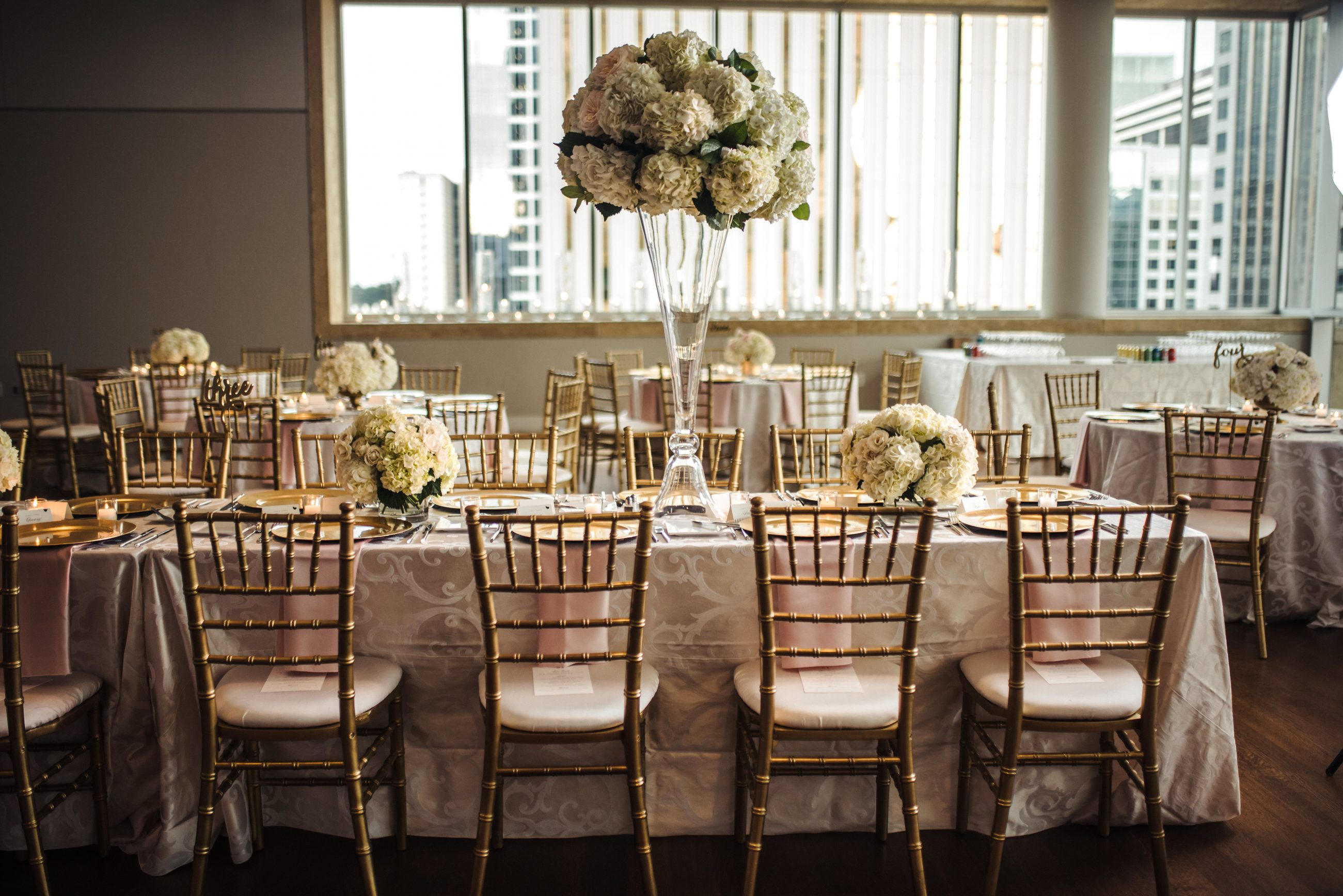 Charlotte wedding reception event tables with gold chiavari chairs rented from Party Reflections