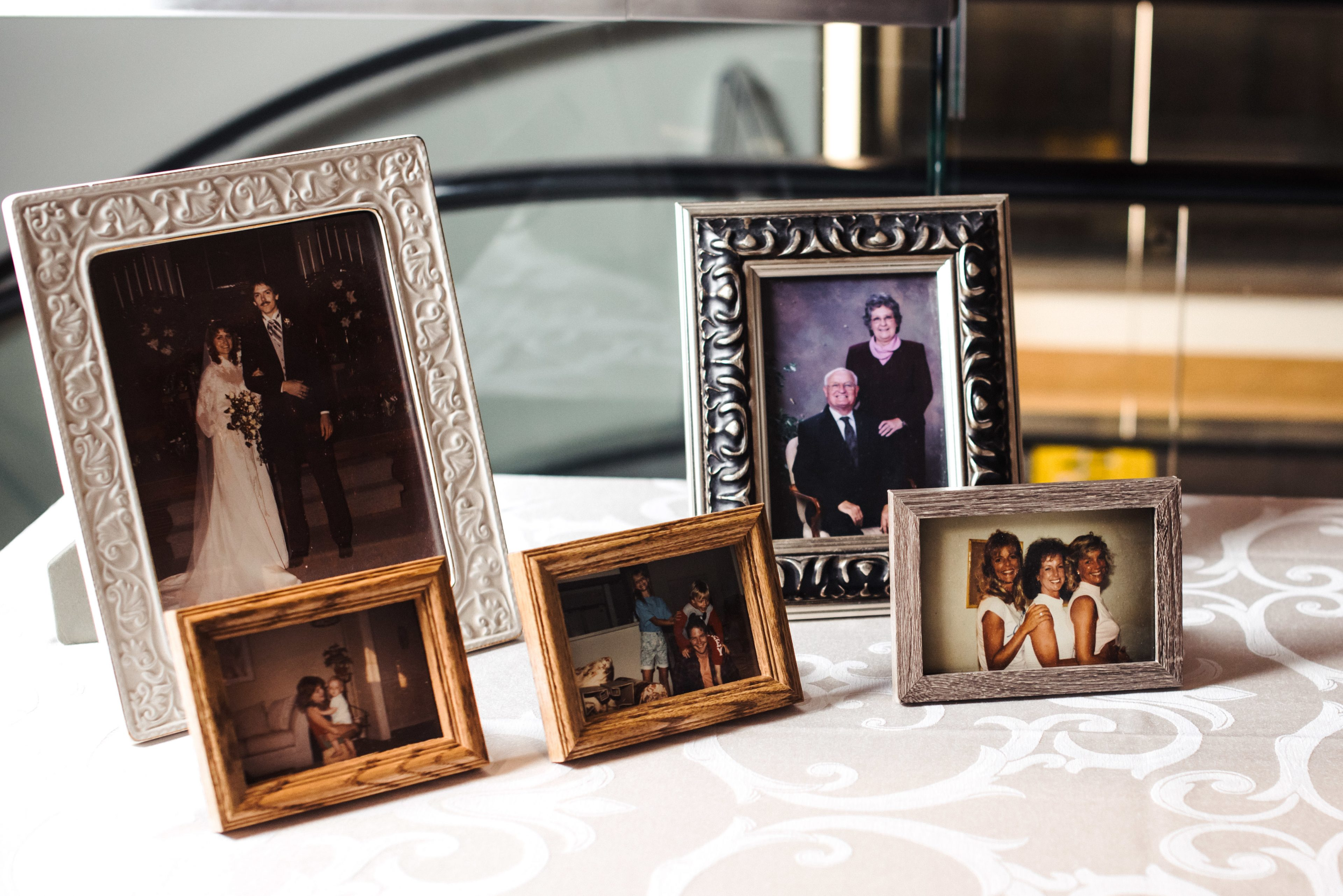 Wedding family photo table at Mint Museum Uptown wedding with coordination provided by Magnificent Moments Weddings
