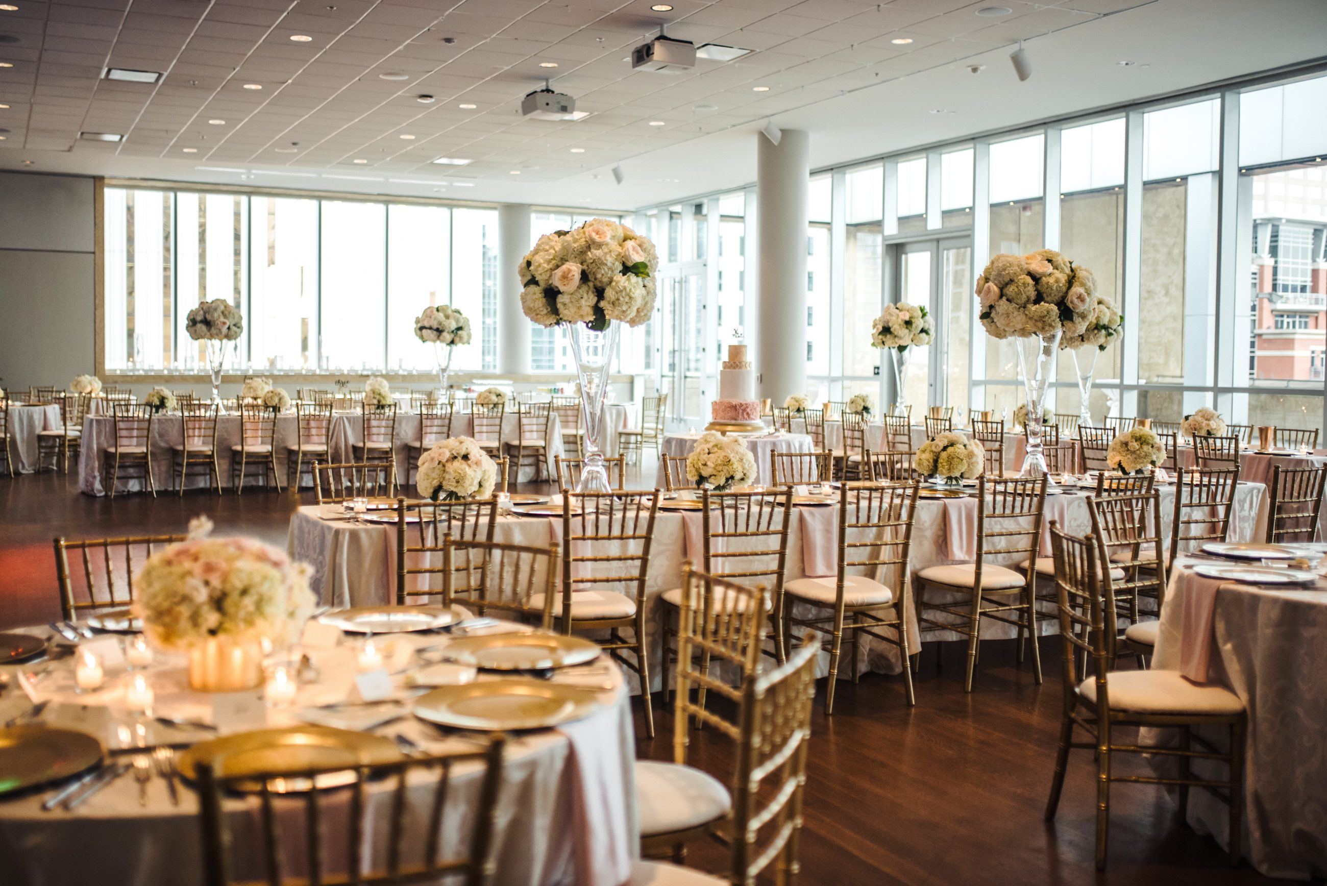 d392b1a56ff9 Wedding reception at Mint Museum Uptown, tables set with white linens from  CE Rentals,