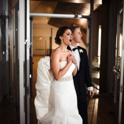Reception room reveal to bride and groom of event space at Mint Museum Uptown captured by Anchor and Veil Photography