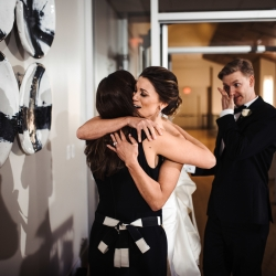 Bride embraces Amanda at Magnificent Moments Wedding for coordinating her Uptown Charlotte Wedding Reception