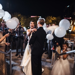 Kara and David's Uptown Mint Museum Wedding grand exit through glowing LED balloons