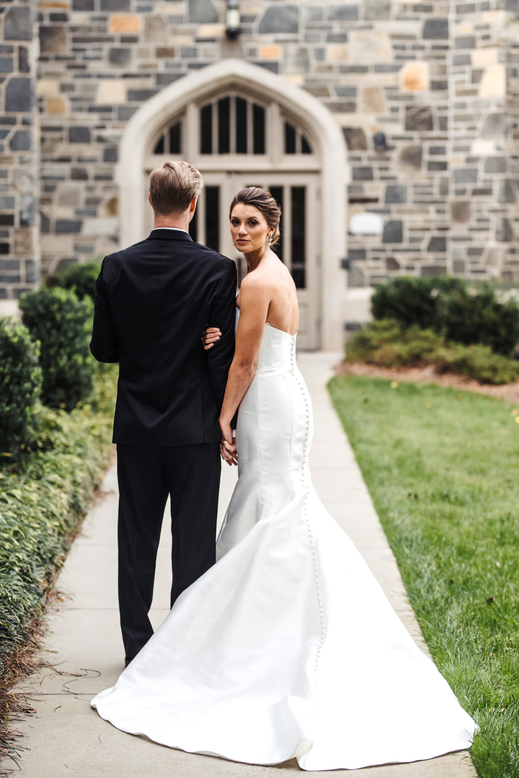 Portrait of bride and groom outside Myers Park Presbyterian Church located in Charlotte North Carolina