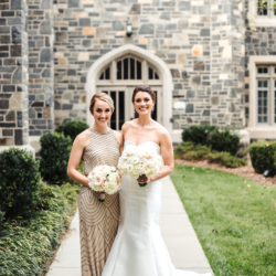 Bride with bridesmaid outside Myers Park Presbyterian Church in Charlotte North Carolina