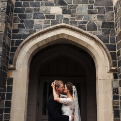 Bride and groom embrace following ceremony at Myers Park Presbyterian Church in Charlotte North Carolina