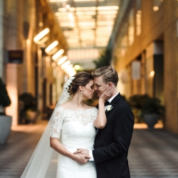 Bride and groom embracing for image on Uptown Charlotte streets captured by Anchor and Veil Photography