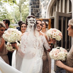 Bride embracing bridesmaids outside Myers Park Church in Charlotte North Carolina, featuring bridesmaids in stunning sequin embellished gold bridesmaids gowns