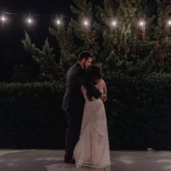 Bride and groom under the market lights at Camellia Gardens