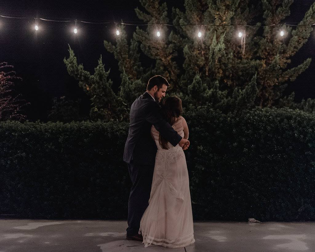 Bride and groom under the market lights at Camellia Gardens