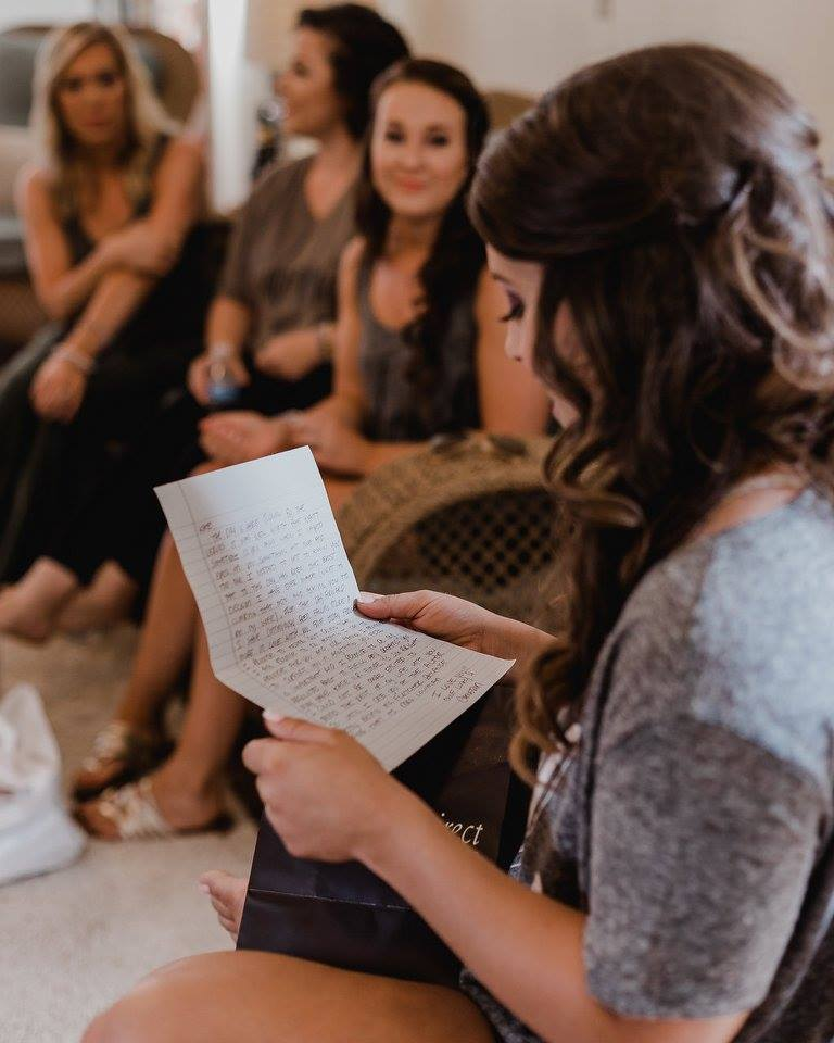 bride reading her letter from her groom