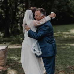 Bride's father giving her a hug