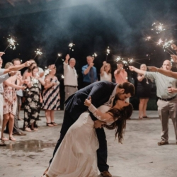 Bride and groom dipping during the sparkler exit