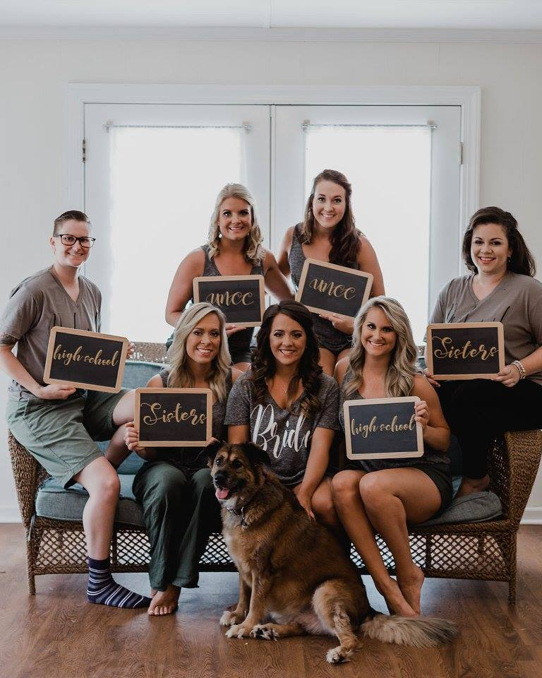 chalkboard signs of how the bridesmaids know the bride