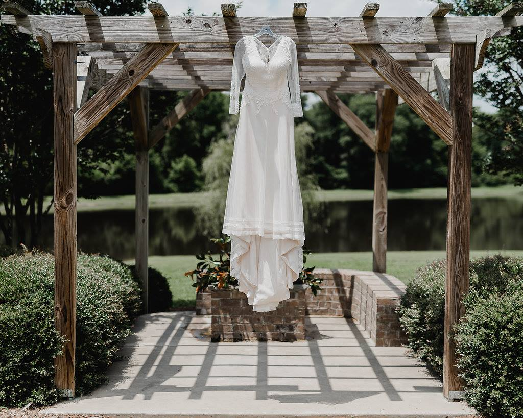 wedding gown hanging up at Camellia Gardens