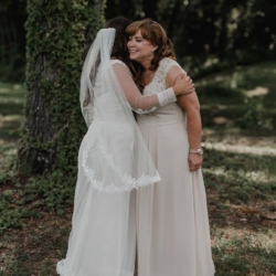 bride hugging her mom on her wedding day