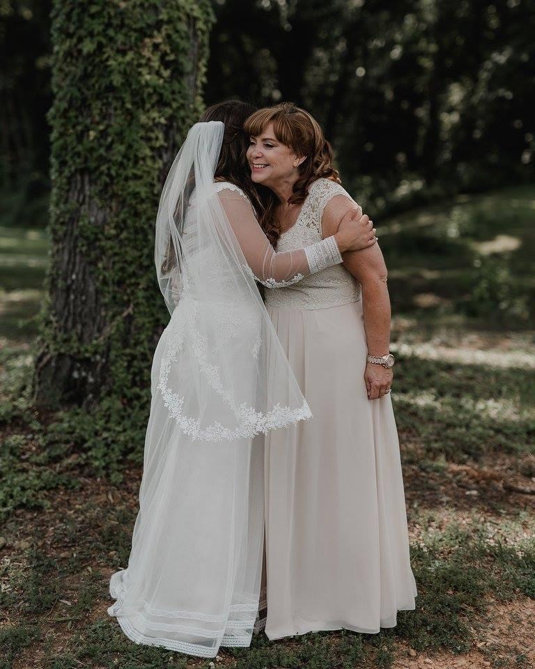 bride hugging her mom on her wedding day