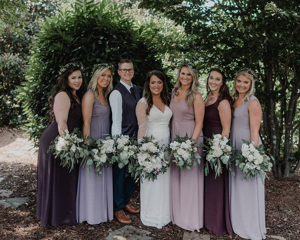Bridesmaids in shades of purple bridesmaid dresses