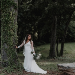 Bridal portrait with ivy growing on a tree