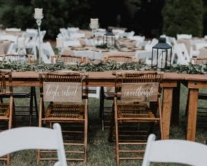 Bride and groom seats at king table for Charlotte wedding reception