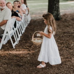 flower girl walking down the aisle