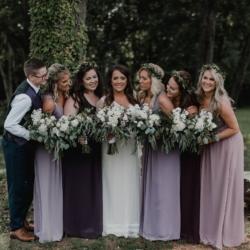bride and bridesmaids in purple dresses