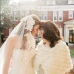 Bride embraces her mother outside of Queen's University Belk Chapel captured by Cameron Faye Photography
