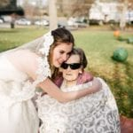 Bride embraces family member during her winter wedding coordinated by Magnificent Moments Weddings