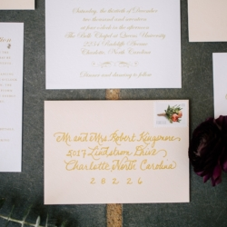 Gold detailed wedding invitation for a Uptown Mint Museum Wedding