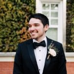 Groom prepares for winter wedding with stunning blush rose boutineer by Jimmy Blooms