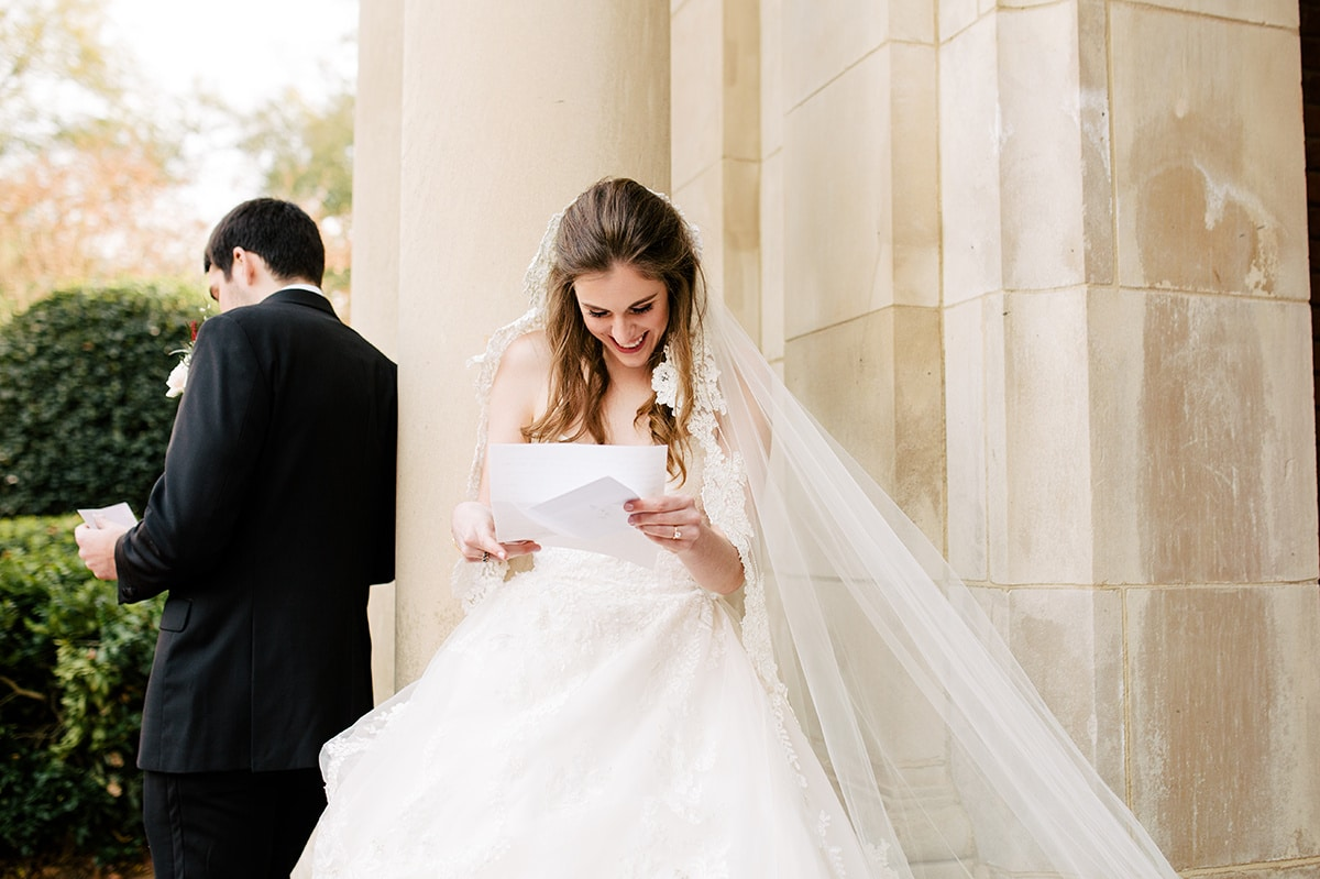 Bride and groom exchange love letters before their ceremony at Queen's University Belk Chapel