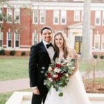 Bride and groom smile after their uptown Charlotte wedding coordinated by Magnificent Moments Weddings