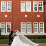 Bride and groom walk together after their Charlotte wedding ceremony captured by Cameron Faye Photography