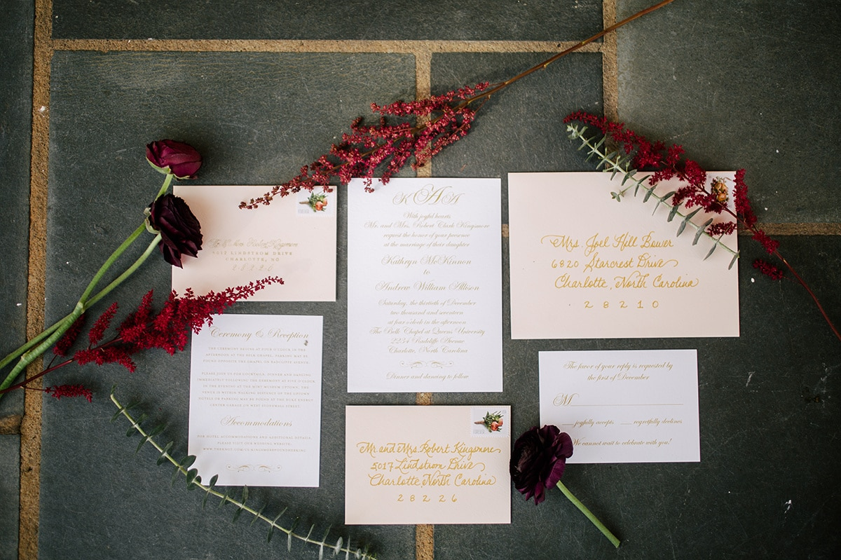 Invitation suite for amazing winter wedding deep red colors complement gold details coordinated by Magnificent Moments Weddings