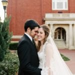 Bride and groom embrace following uptown Charlotte Wedding ceremony coordinated by Magnificent Moments Weddings