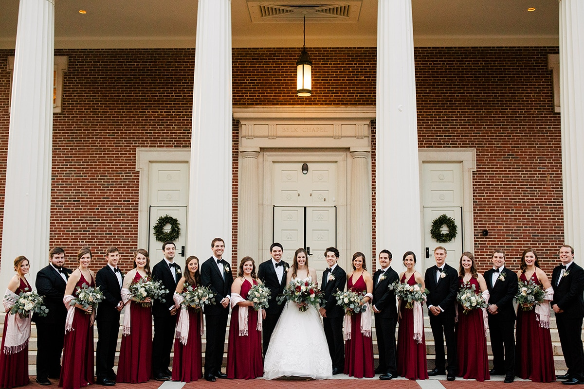 bridal party outside of Queen's university Belk Chapel after winter wedding