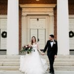 Bride and groom leaving wedding ceremony at Queen's University Belk Chapel