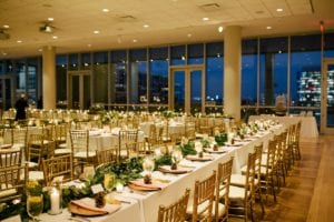 Mint Museum Uptown Charlotte set for winter wedding complete with gold chiavari chairs rented from Carolina Luxury Event Rentals and set off by garland centerpieces by Jimmy Blooms