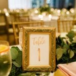 Gold framed table number captured by Cameron Faye Photography