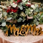 Sweet heart table accented with blush sequin linen and stunning winter floral arrangement by Jimmy Blooms