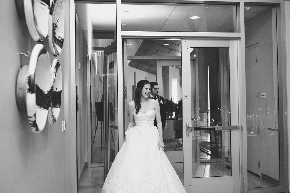 Bride and groom reception introduction into Mint Museum Uptown Charlotte Wedding coordinated by Magnificent Moments Weddings
