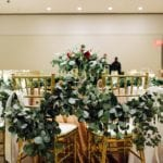 Romantic garland by Jimmy Blooms draped on sweetheart gold chiavari chairs rented from Carolina Luxury Event Rentals