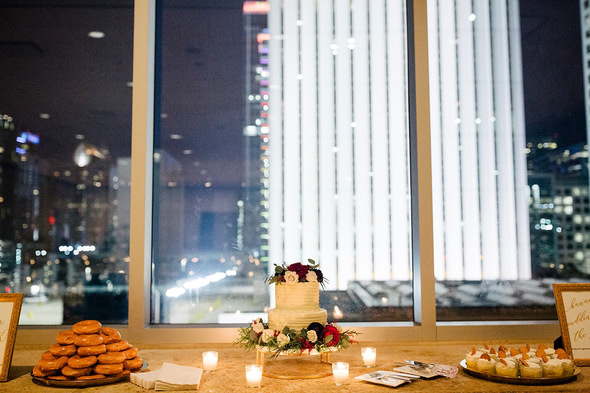 Simple white cake by Edible Art Cake Shop and Krispy Kreme doughnuts serve as desserts for this Uptown Charlotte Wedding