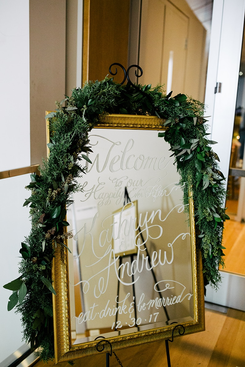 Mirror welcomes guest to a beautiful winter wedding coordinated by Magnificent Moments Weddings