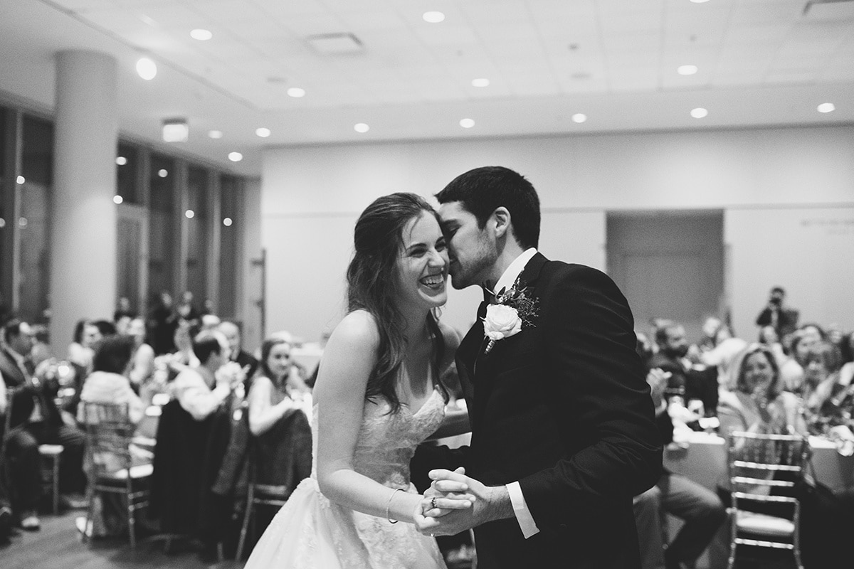 Bride and groom enjoy a first dance to music provided by Split Second Sound at their Uptown Mint Museum Wedding in Charlotte NC