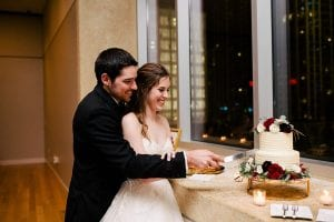 Bride and groom cut cake at Mint Museum Uptown wedding coordinated by Magnificent Moments Weddings
