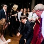 Wedding guests dance the night away to Split Second Sound at a Uptown Charlotte Wedding