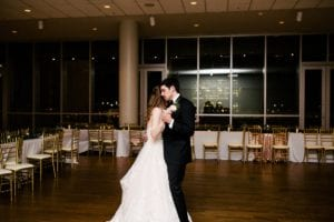 Private last dance between bride and groom at Mint Museum Uptown wedding coordinated by Magnificent Moments Weddings