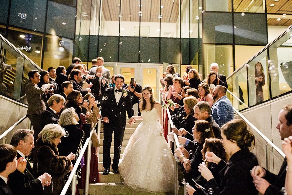 Bubble send off to winter wedding at Mint Museum Uptown Charlotte coordinated by Magnificent Moments Weddings