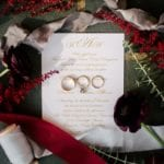 Wedding invitation and wedding rings captured by Cameron Faye Photography for a Uptown Mint Museum Wedding