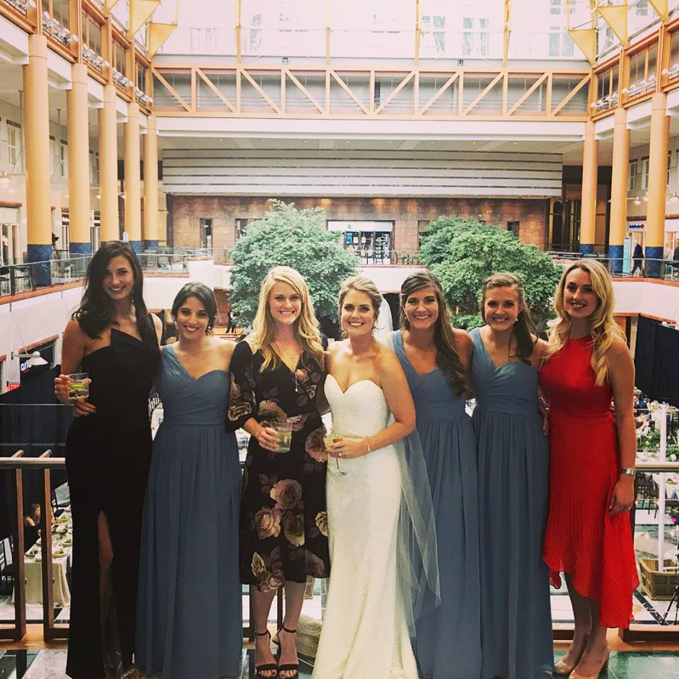 Bridal party photo under amazing glass ceiling at Founders Hall wedding in Uptown Charlotte coordinated by Magnificent Moments Weddings